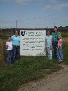 My girls and I a couple of years ago in front of my biosecurity sign.  The young woman pictured with us now works for Senator Mike Johanns in Washington DC...