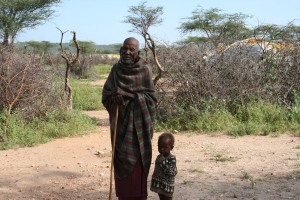 A Samburu Elder with his child...The Samburu continue to be a semi-nomadic people based on a hunter-gatherer culture.