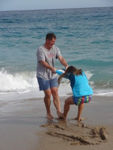 "16 and a half years later, Matt ""encouraging"" our oldest daughter (a Nebraska prairie girl) to try a taste of ocean life..."