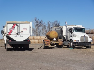 Here we are fueling the feed trucks--it's no fun to fuel equipment in the middle of a blizzard...