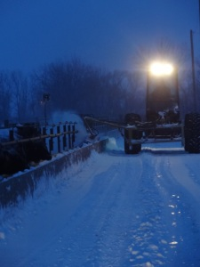 Removing snow from the feed bunks before dawn so that we could get breakfast to the cattle...