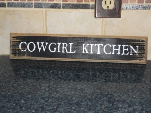A special thanks to my cousin Mary Laura for sending this awesome kitchen sign all the way from the East Coast to Megan :)