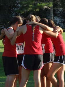 My favorite teenage in a huddle with her teammates before the Junior High race...