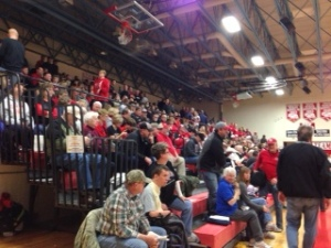 A gym full of small town community members that traveled the extra mile to cheer on their team...