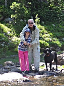 Dad and Karyn searching for the elusive trout while a loyal four legged friend stands guard...