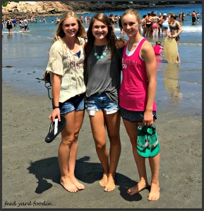 The girls took a brief moment to dig their toes in the sand on the beach in Maine -- remarking that there were likely more people on that beach than our entire town of Cozad...